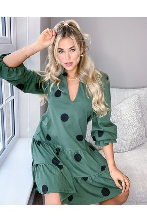 ASOS Tiered long sleeve spot smock dress in khaki and black spot
