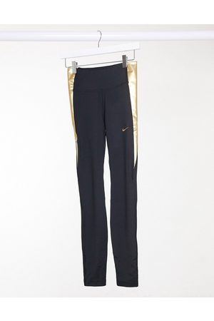Nike One tight leggings in black and gold