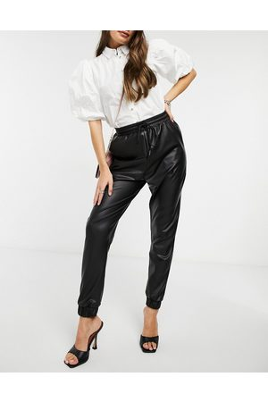ASOS Hourglass leather look jogger in black