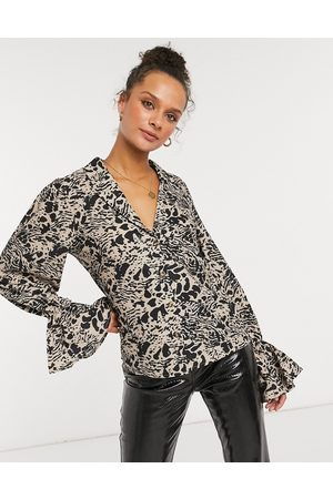 In The Style X Shaughna plunge front top with fluted sleeve in animal print