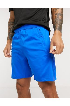adidas Training tonal stripe shorts in blue
