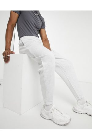 ASOS Oversized joggers with pocket detail in white marl