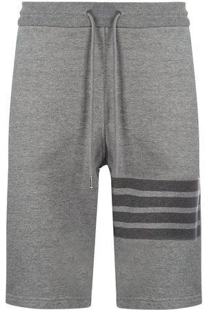 Thom Browne Shorts deportivos a rayas