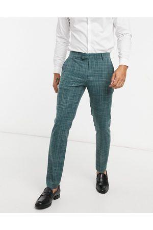 ASOS Wedding skinny suit trousers in pine green crosshatch