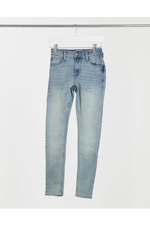 ASOS Super skinny ankle grazer jeans in light blue vintage tint