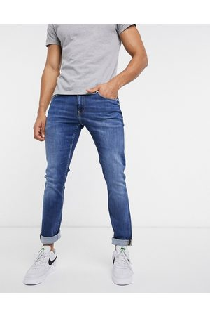 Calvin Klein Hombre Skinny - Slim fit jeans in mid wash