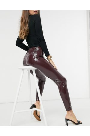 River Island Vinyl skinny trousers in burgundy