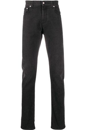 Alexander McQueen Jeans slim con tiro medio
