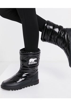 sorel Joan Of Arctic padded snow boots in black patent