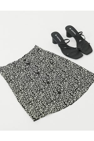 ASOS Mini skirt with side button detail in animal print
