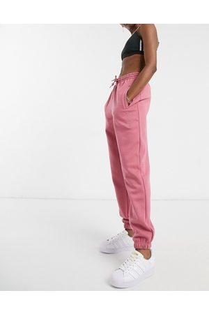 adidas Cosy Comfort' oversized cuffed joggers in pink