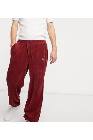 PUMA Cord joggers in burgundy exclusive to ASOS