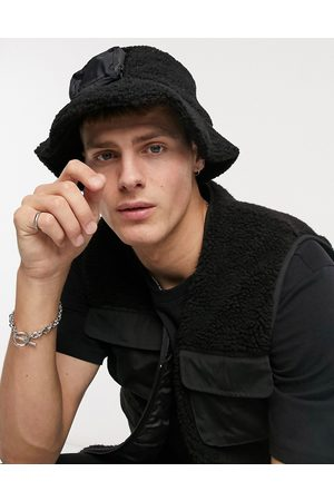 ASOS Modular bucket hat in black borg and nylon with removeable coin pouch