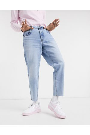 ASOS Classic rigid jeans in vintage light wash blue with raw hem