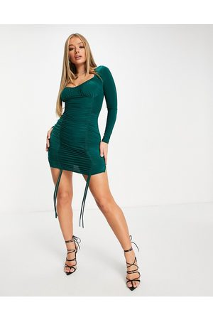 Femme Luxe Sweetheart neck ruched tie front mini dress in emerald green