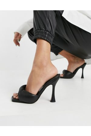ASOS Niki padded twist high heeled mules in black