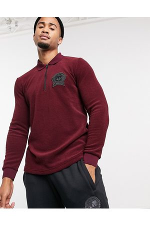 adidas Originals Long sleeve polo top with collegiate crest in burgundy terry toweling