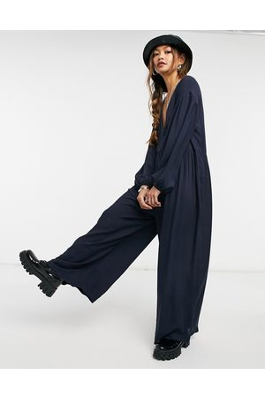 ASOS Mujer Largos - Wrap smock jumpsuit with button in navy