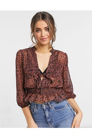 ASOS Sheer long sleeve top with shirred waist in splodge print