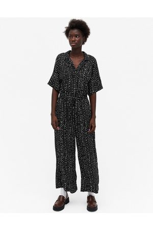 Monki Kalolo short sleeve jumpsuit in black and