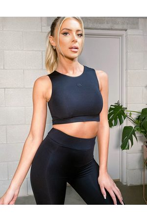 The O Dolls Collection ODolls Collection logo crop top in black