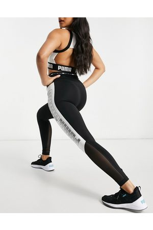 PUMA Training high waisted block leggings in black
