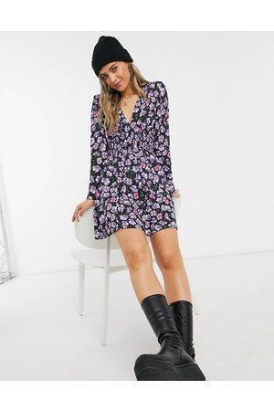 ASOS Padded shoulder long sleeve ruched waist mini dress in blue and purple floral print