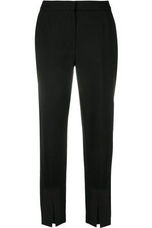 Alexander McQueen Pantalones de vestir con detalles de aberturas