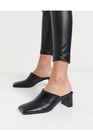 ASOS Surreal premium leather mid heeled mules in black