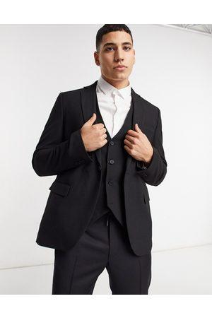 Bolongaro Plain skinny suit jacket in black