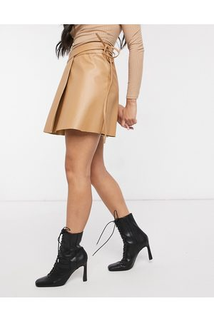 ASOS Leather look wrap mini skirt with tie detail in tan