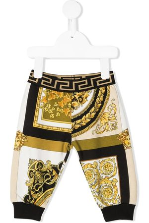 VERSACE Leggings y treggings - Joggers con estampado Barocco