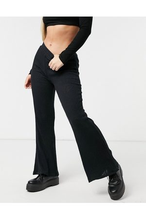 Cotton On Mujer Leggings y treggings - Ribbed wide leg trousers in black