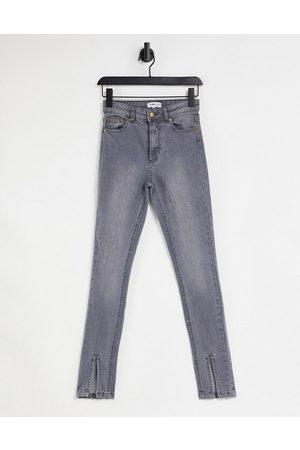 Femme Luxe Split front jean in washed grey