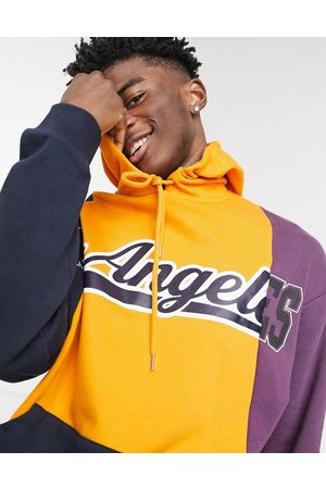 ASOS Oversized hoodie with spliced Los Angeles collegiate panels