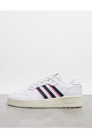 adidas Rivalry Low trainers in white with navy stripes