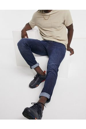 HUGO BOSS Taber tapered fit jeans in mid wash