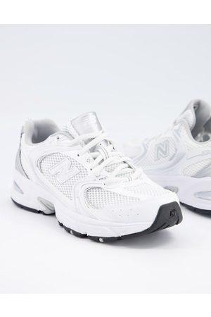 New Balance 530 metallic trainers in white