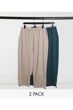 ASOS Super oversized joggers with toggle hem in beige/teal 2 pack