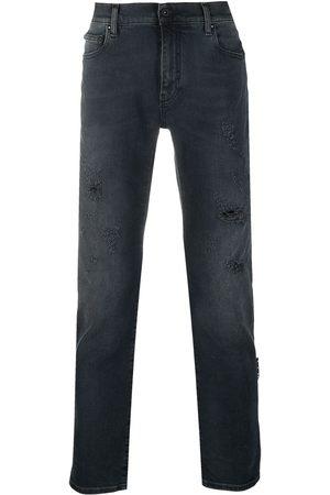 OFF-WHITE Jeans bootcut con detalles rasgados