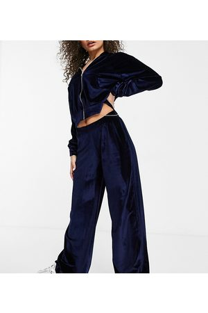 Fashionkilla Exclusive velour wide leg trouser co ord in navy