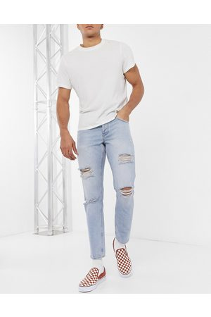 ASOS Slim jeans in vintage light wash blue with heavy rips