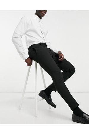 ASOS Hombre Slim y skinny - Wedding super skinny suit trousers in black micro texture