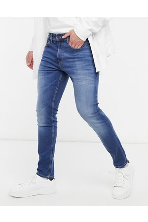 Tommy Hilfiger Hombre Skinny - Austin slim tapered jeans in mid wash