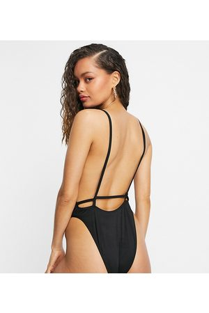 ASOS ASOS DESIGN petite recycled twist strappy low back swimsuit in black