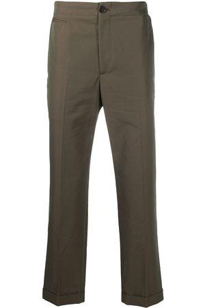 Alexander McQueen Pantalones chino con franjas del logo