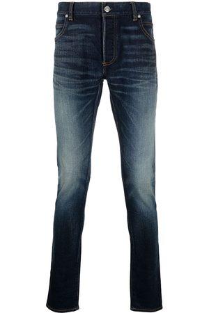 Balmain Jeans slim con efecto descolorido