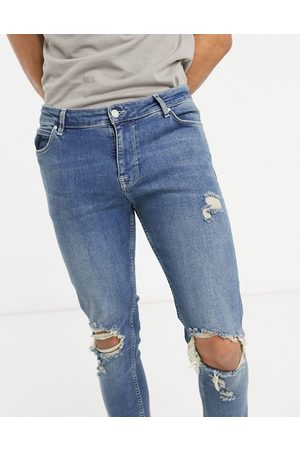 ASOS Skinny jeans in dirty mid wash blue with rips