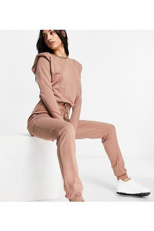 ASOS ASOS DESIGN tall long sleeve shoulder pad jogger jumpsuit in brown