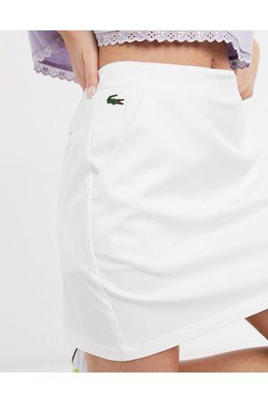 Lacoste Logo detail mini skirt in white